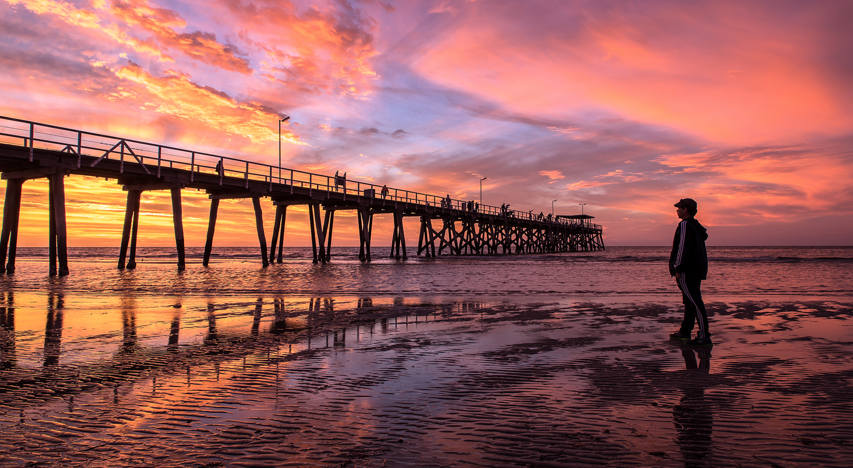 Sun sets over Largs Bay jetty.