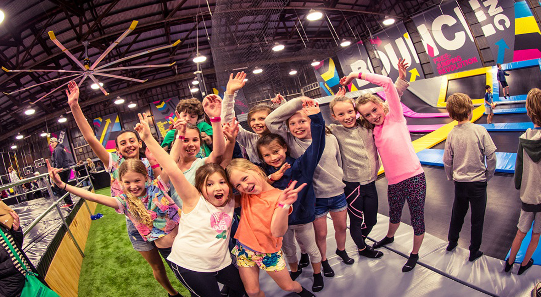 Group of children smiling at camera at BOUNCEinc.