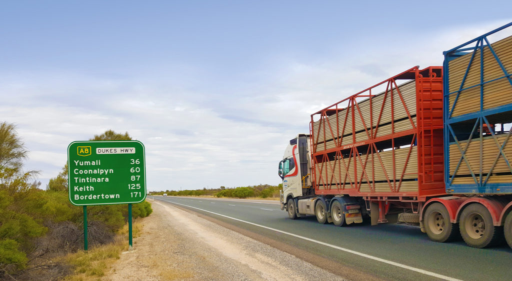 Dukes Hwy with livestock truck passing sign