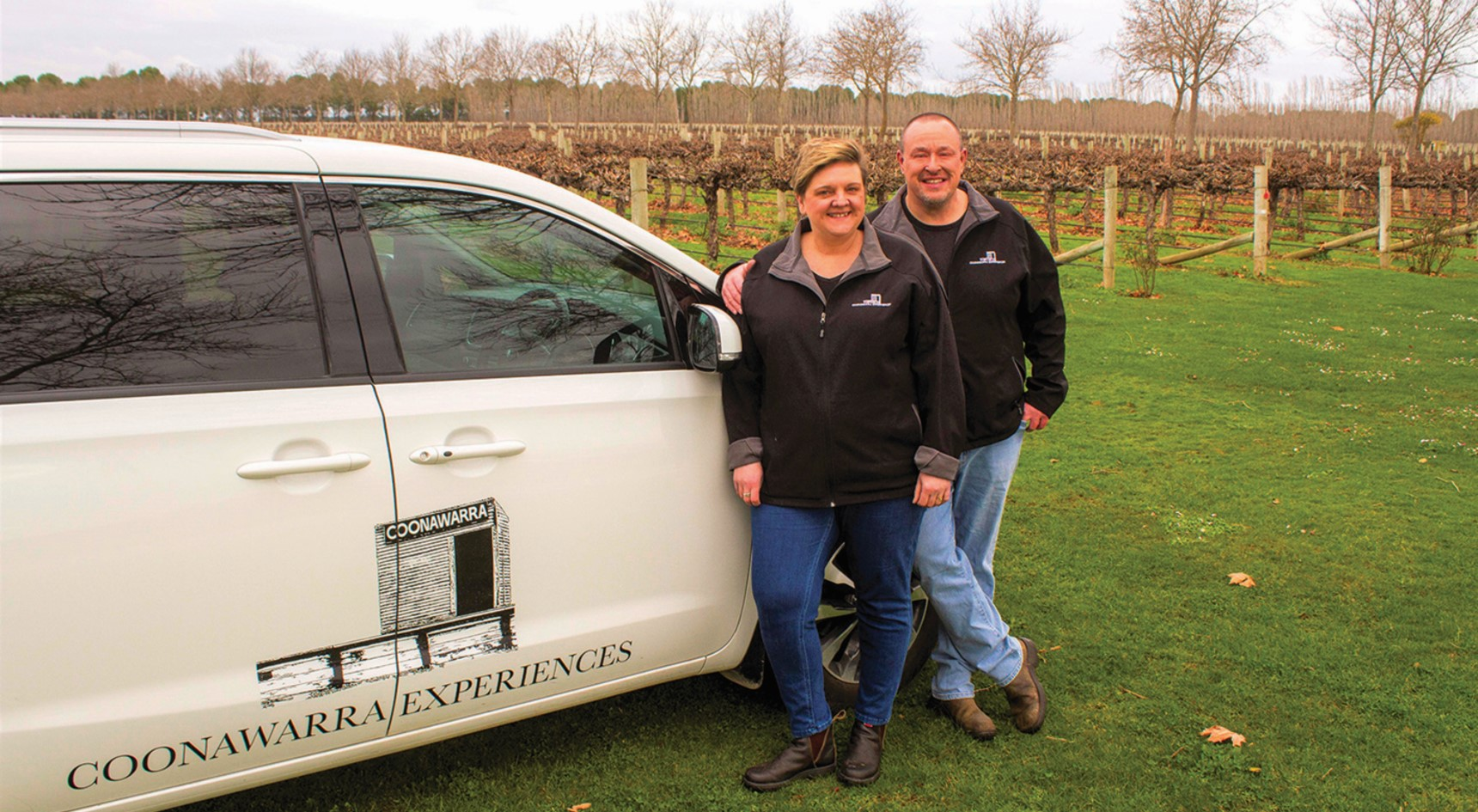 Simon and Kerry Meares stand in a vineyard in the Coonawarra beside their car. Image: Jamie McDonald